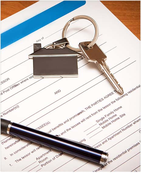 keys and pen on top of a family law document